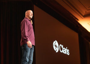 Photo of Brad Frietag announcing the company's name change to from FileMaker to Claris